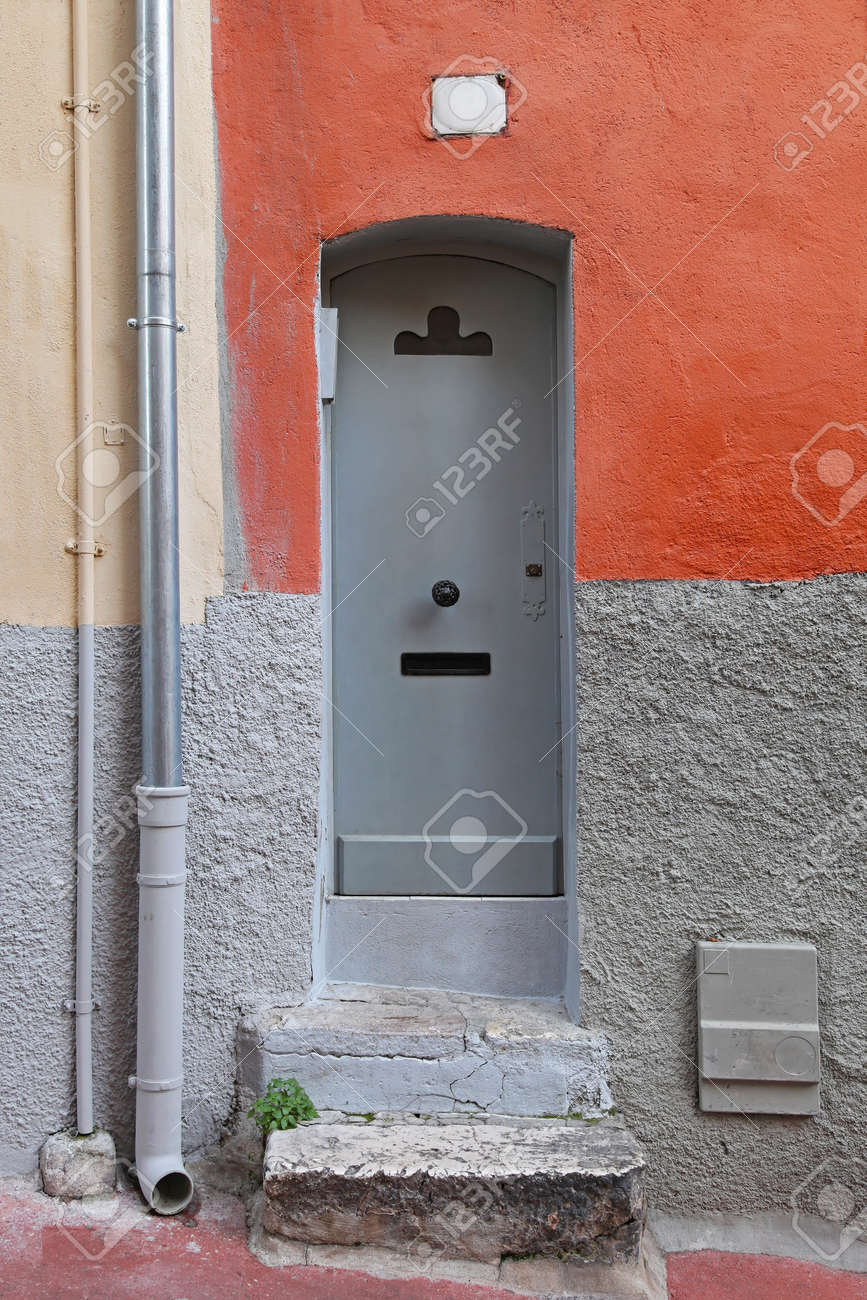 Narrow gray door at house with steps Stock Photo - 16617413