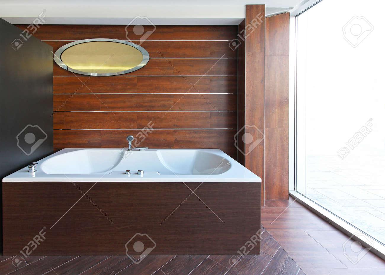 Big hydro massage bathtub in wooden bathroom Stock Photo - 16732510