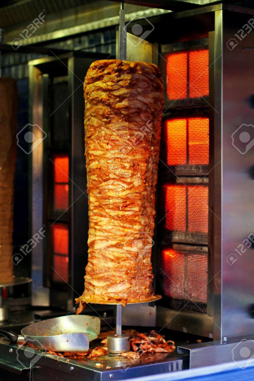 Aligned meat on metal stick roasting on street vendor Stock Photo - 17123478