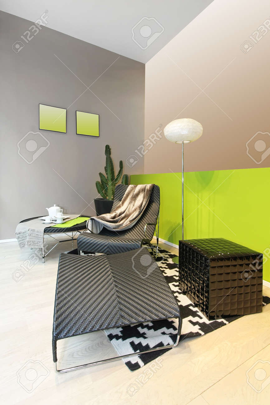 Armchair and foot stool in launge room Stock Photo - 17213757