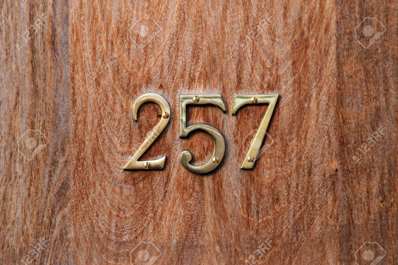 Gold house number plates on wooden door Stock Photo - 17231568