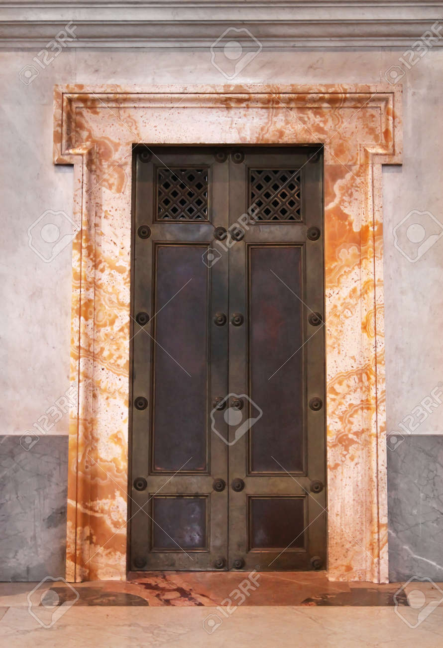 Beau Armored Iron Door With Marble Frame In Vatican Stock Photo   17963935