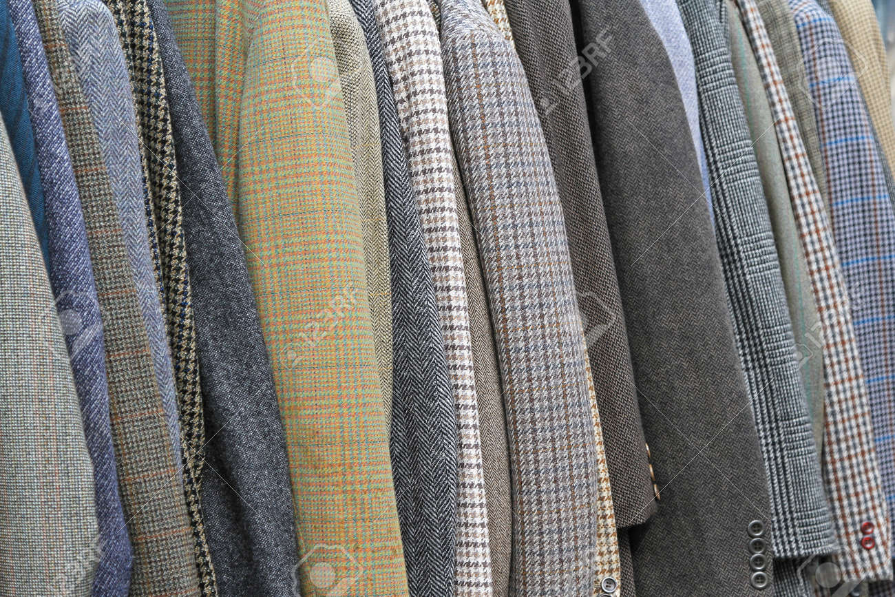 Vintage style suits and coats at rail Stock Photo - 19983189