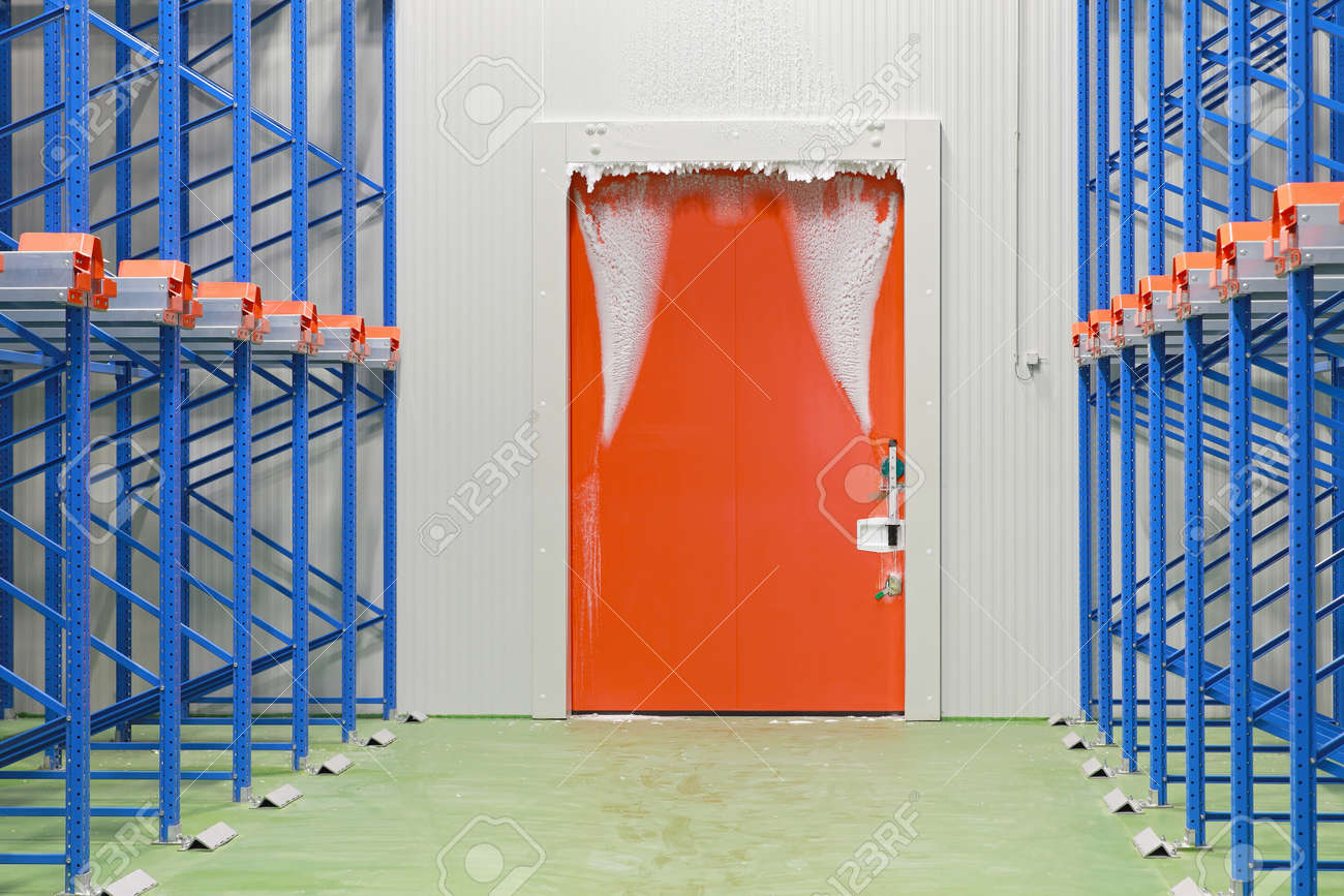 Warehouse freezer door covered in frost and ice Stock Photo - 20481676