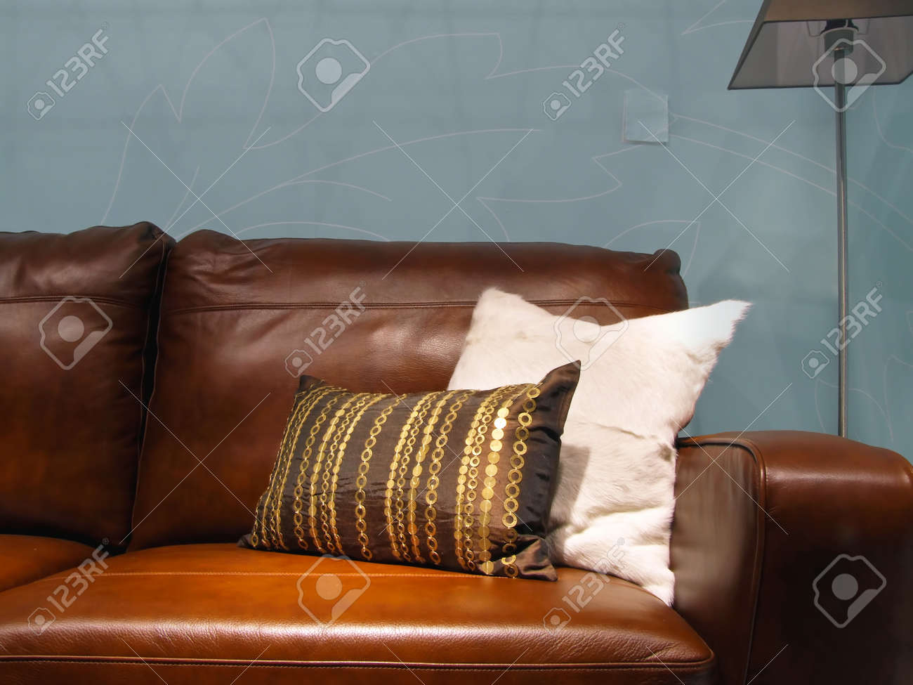 Two Decorative Pillows At Brown Leather Sofa Stock Photo Picture And Royalty Free Image Image 22283479