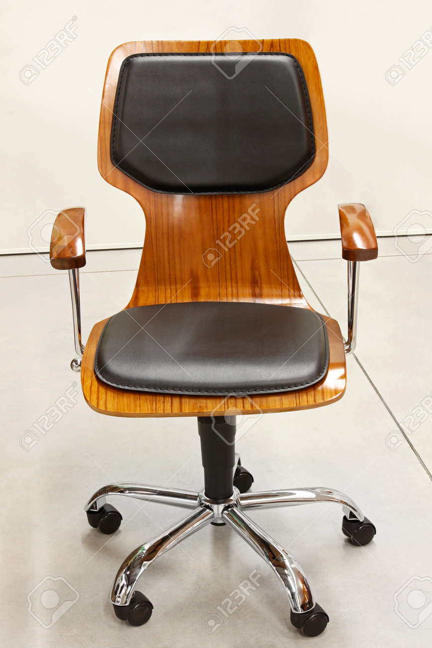 modern wooden office chair with leather cushions stock photo