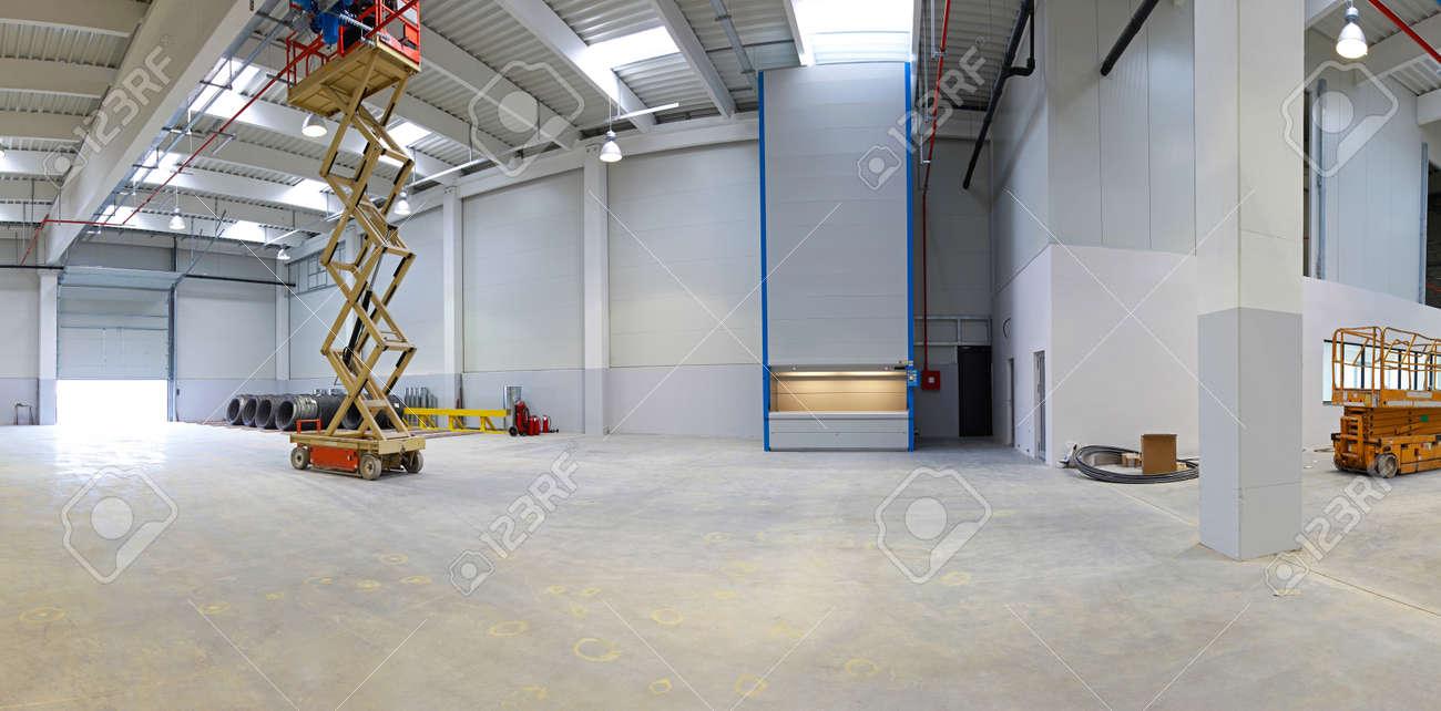 New factory hall with hydraulic scissors lift platform