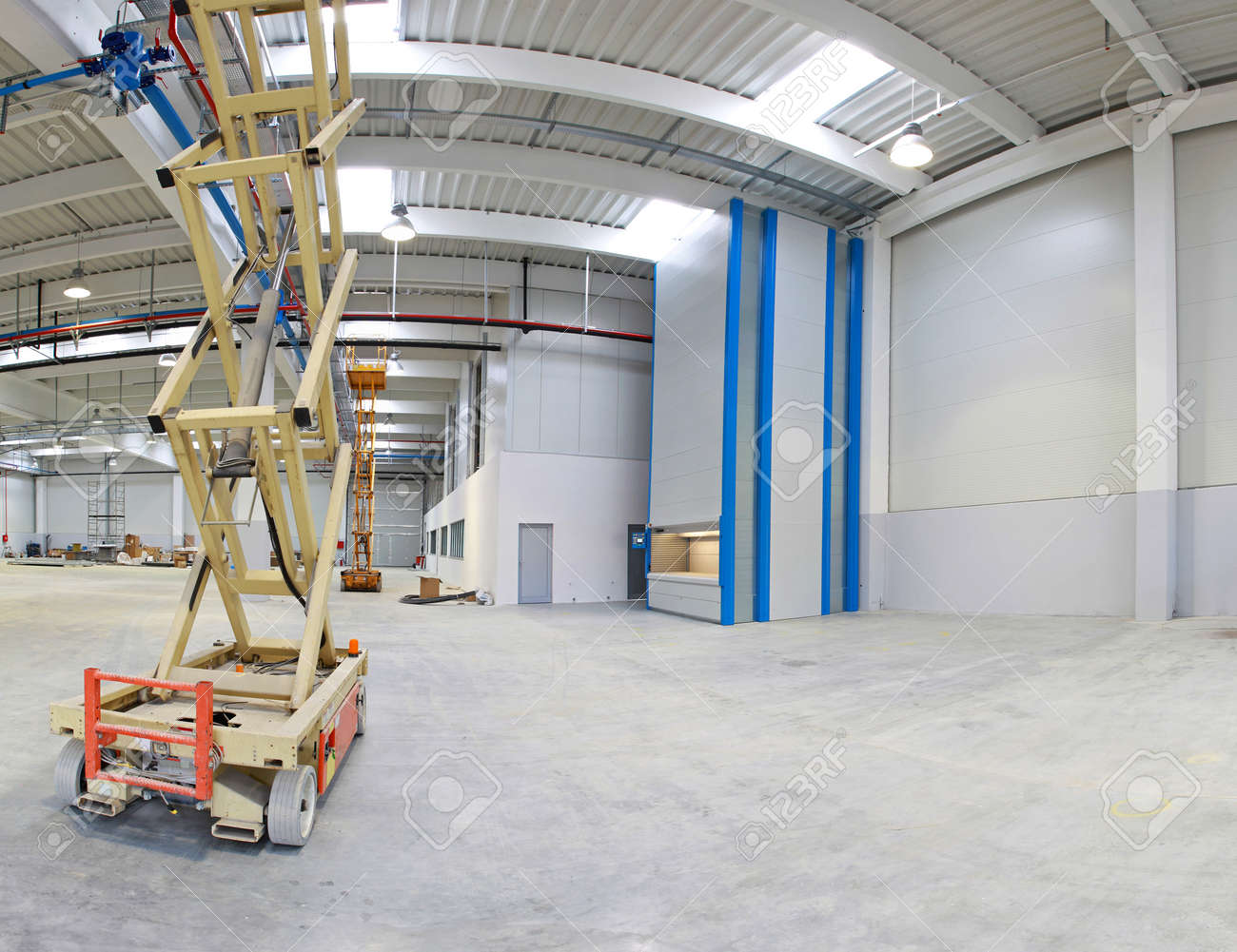 New distribution warehouse hall with hydraulic scissors lift