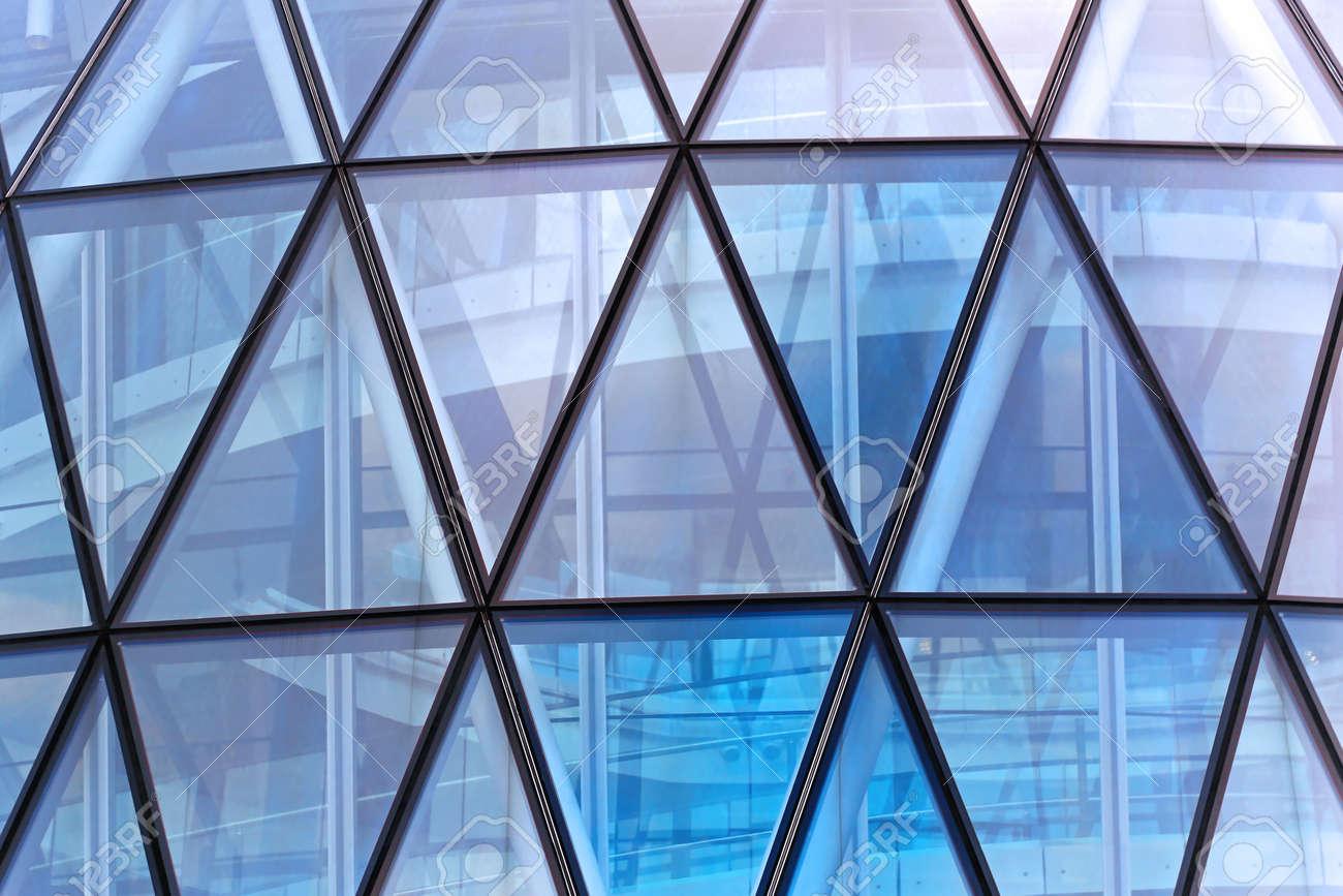 Glass office windows - Blue Glass Triangular Windows At Office Building Stock Photo 30906662