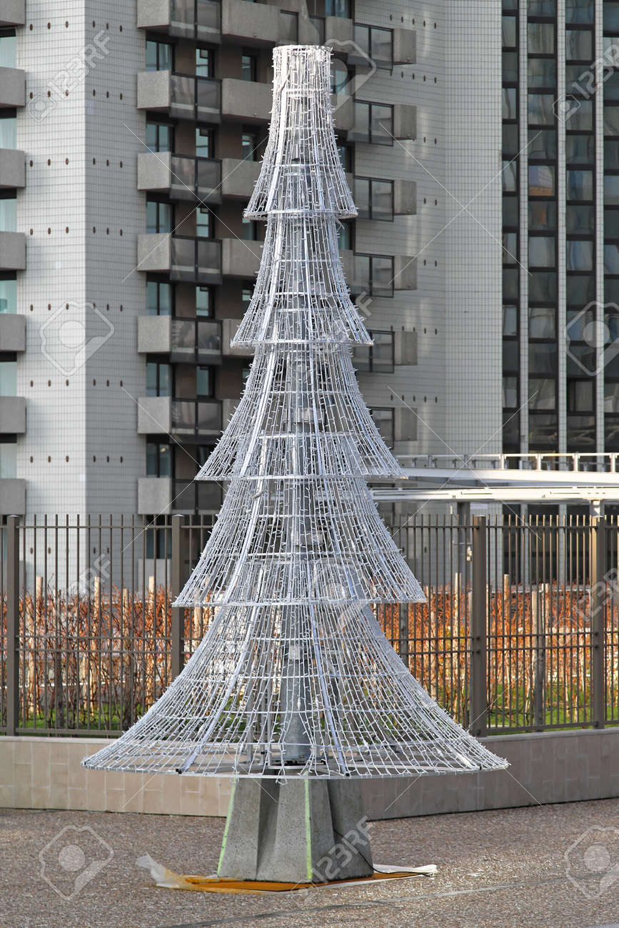 Metal Christmas Tree.Modern Christmas Tree Made From Metal With White Lights