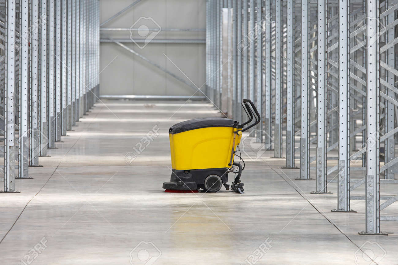Walk behind scrubber machine for cleaning warehouse floor stock walk behind scrubber machine for cleaning warehouse floor stock photo 45380692 dailygadgetfo Images