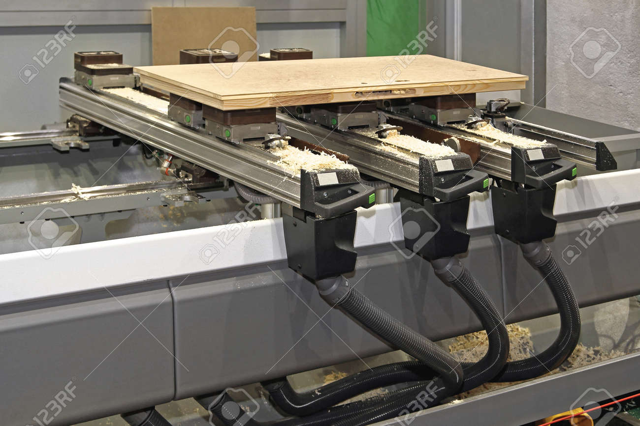 Cnc Woodworking Machine In Wood Work Shop Stock Photo Picture And
