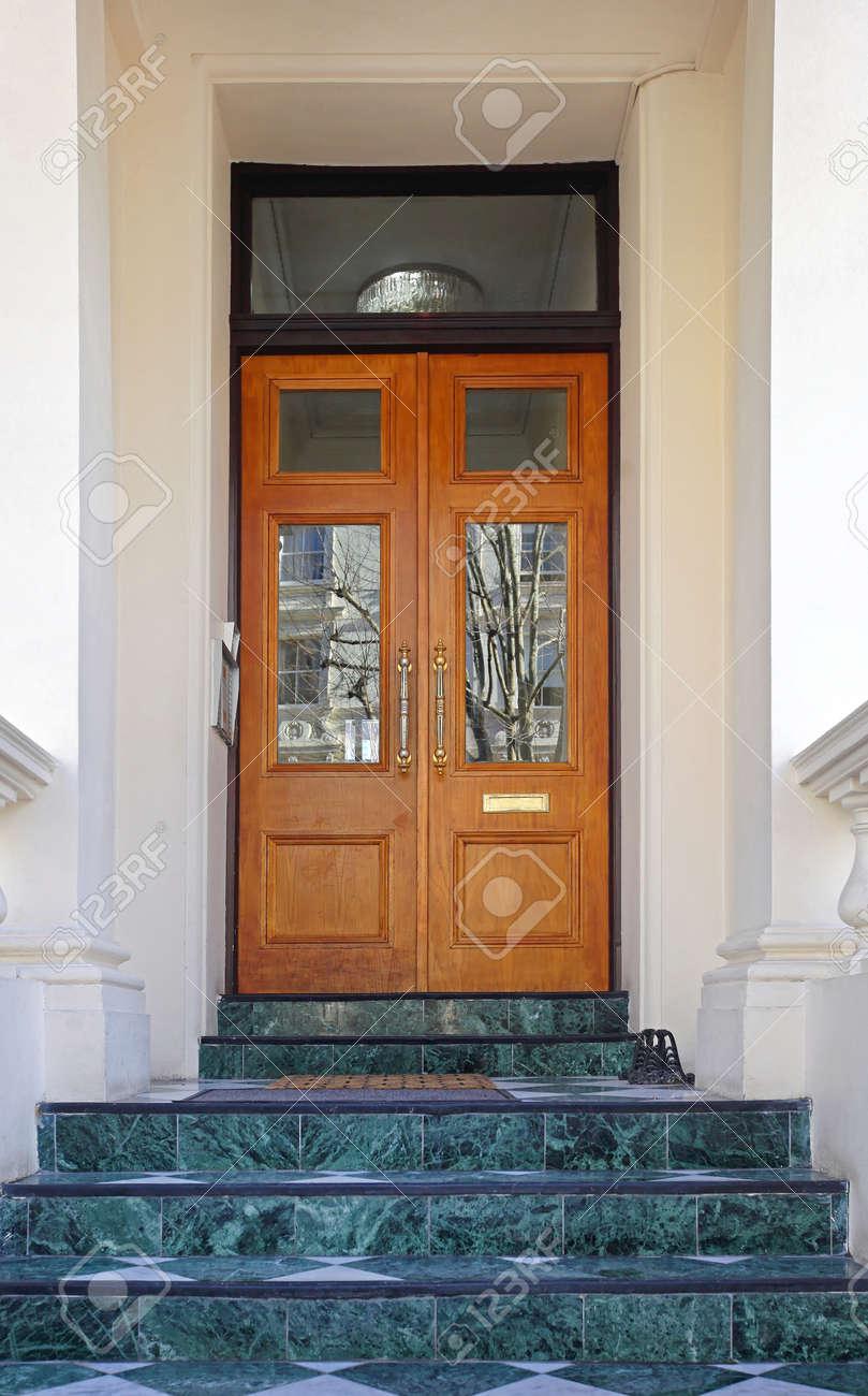 Double door house entrance with stairs stock photo picture and double door house entrance with stairs stock photo 83424042 rubansaba