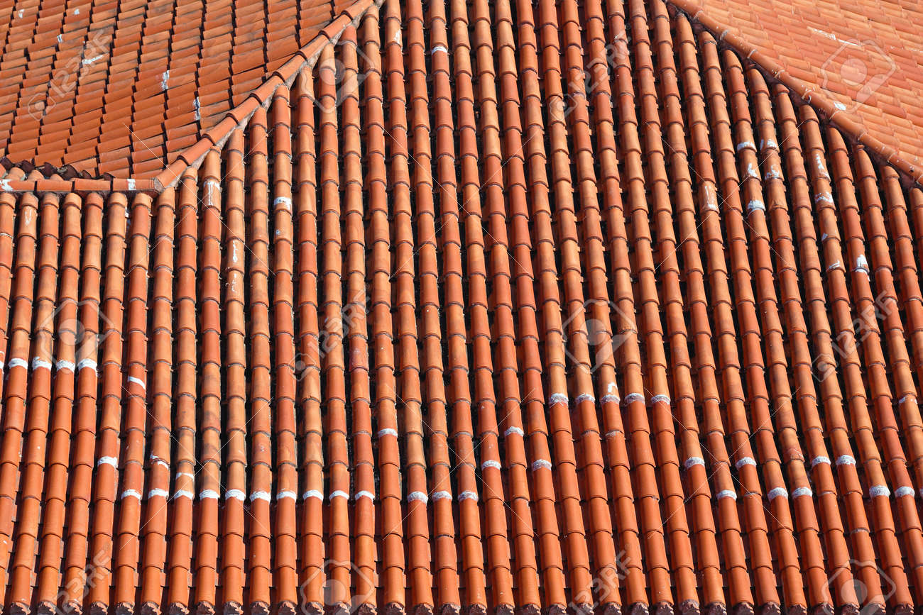 Terracotta ceramic roof tiles from above stock photo picture and terracotta ceramic roof tiles from above stock photo 85290975 dailygadgetfo Gallery