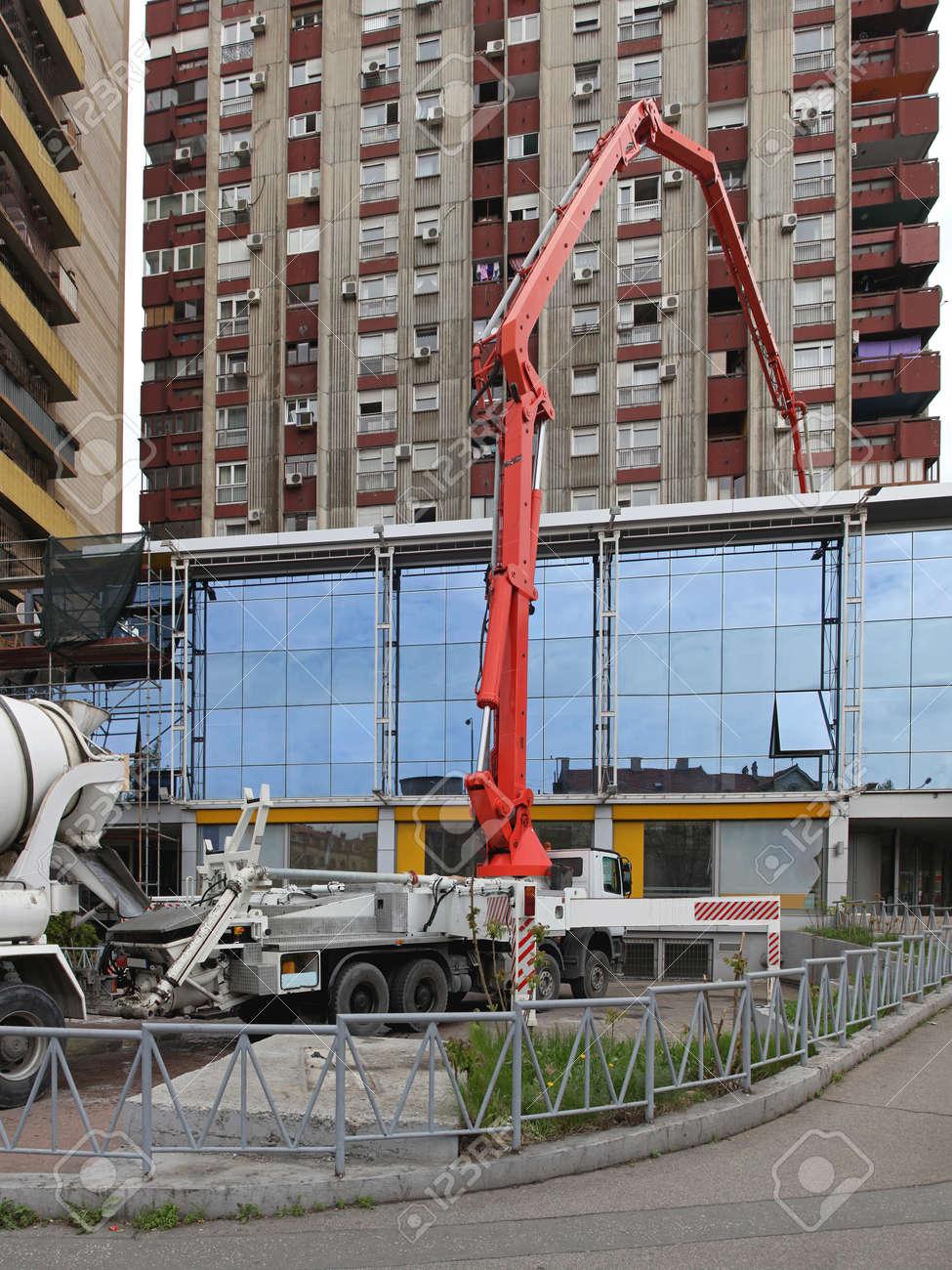 Concrete Pump Truck at Building Construction Site