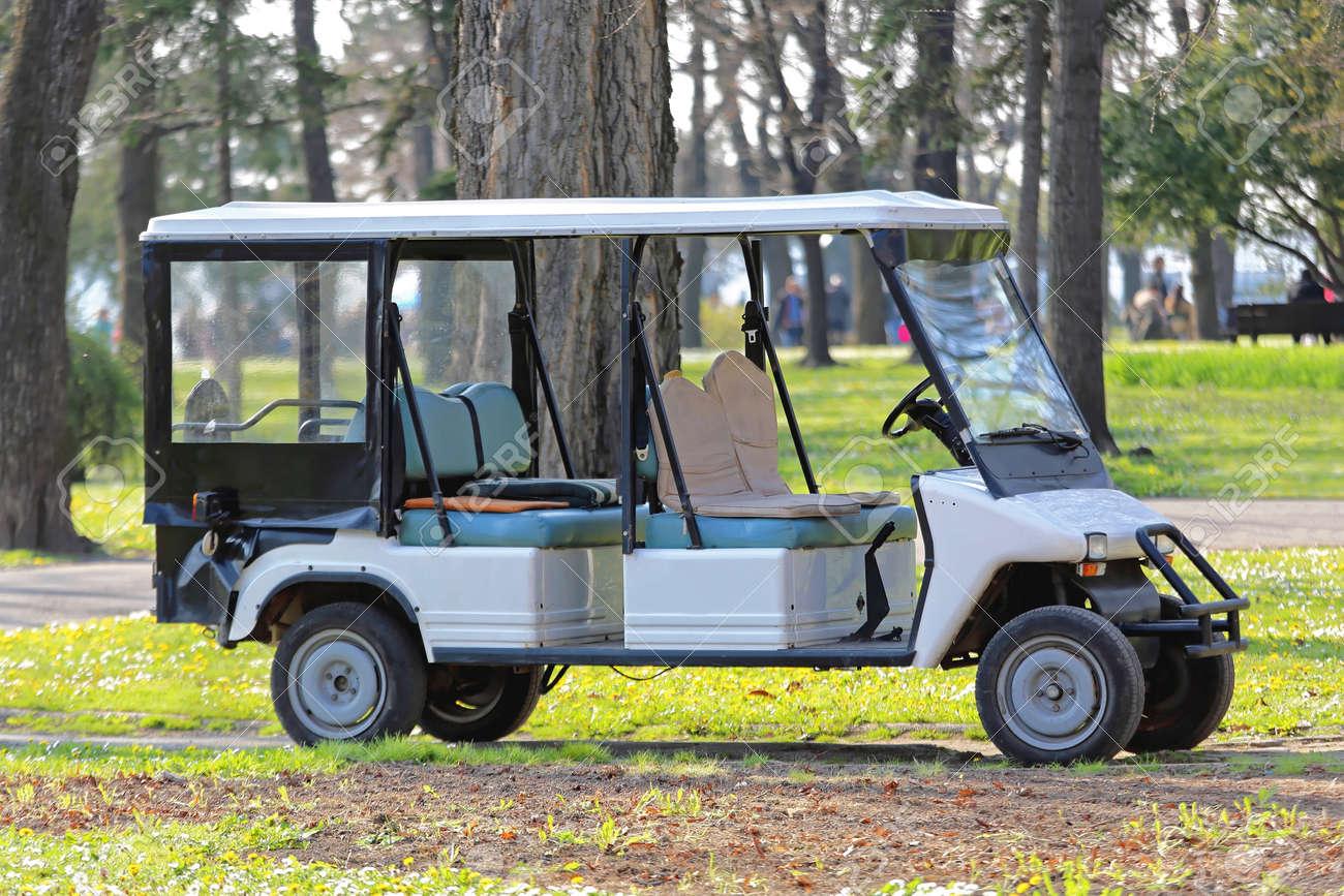 Big Electric Golf Cart In Park Stock Photo, Picture And Royalty Free on big golf discounts, big excavators, big dog cart, big storage, dough boyz custom carts, big max golf, big golf mats, two seater carts,