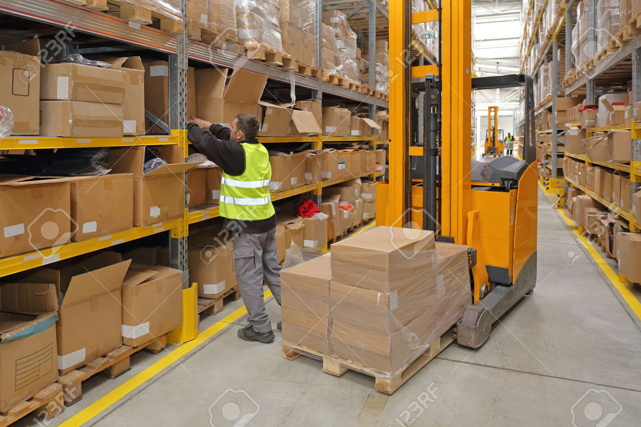 Worker Order Picking in Fulfillment Warehouse - 103832311