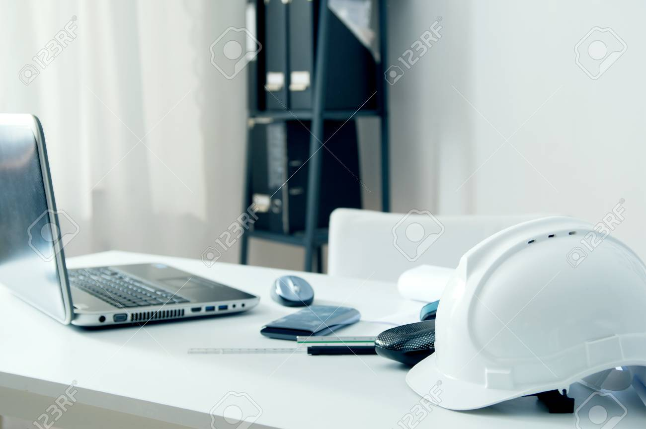 Home Office Of An Architect With White Helmet, Laptop Pc And.. Stock ...
