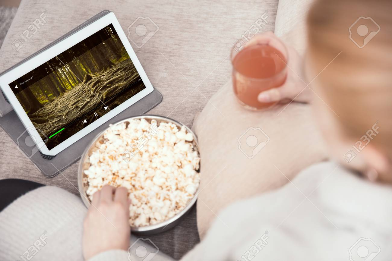 eating a royalty watches movie free more while photo picture stock caveman ca popcorn