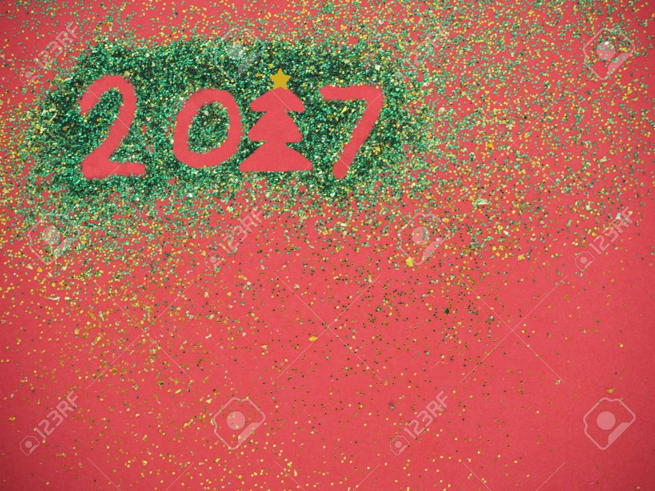 create merry christmas and happy new year card on red background copy space stock photo