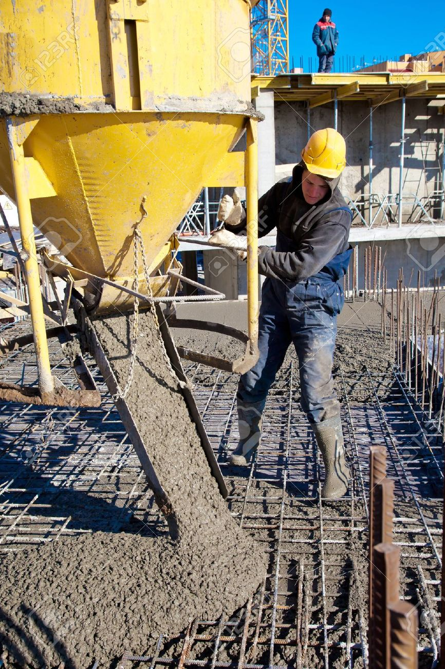 284a1d849b8f9 Construction worker pouring concrete during commercial concreting floors  and building reinforced concrete structures Stock Photo -