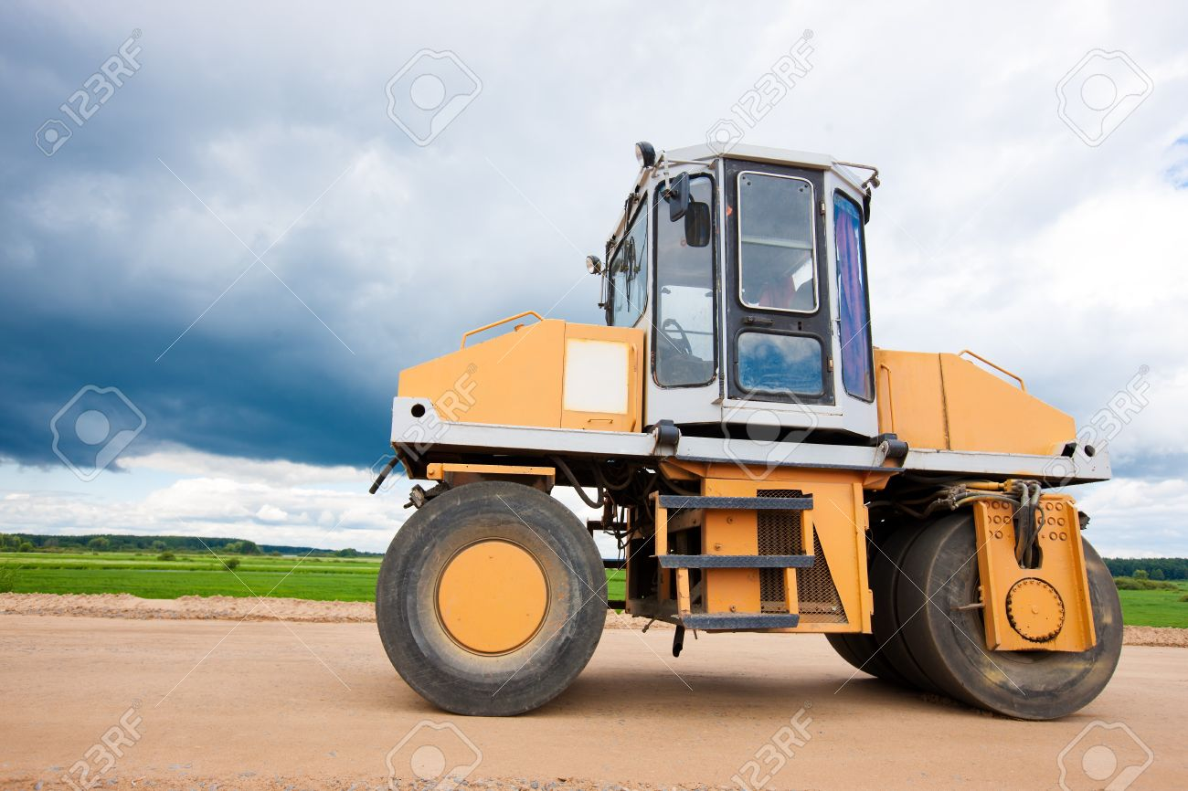 Vibroroller compacting soil during road construction Stock Photo - 21746171
