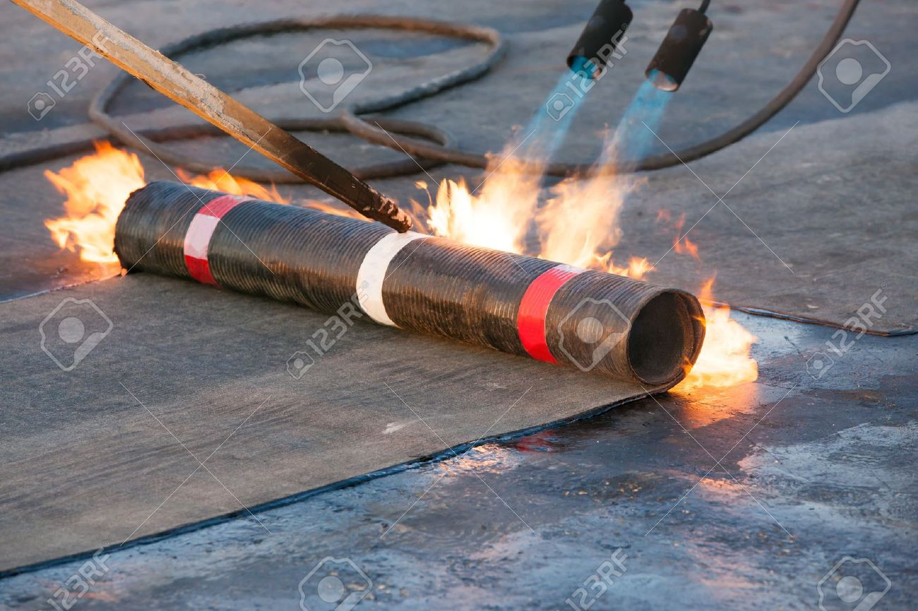 Roll Roofing Installation With Propane Blowtorch Stock Photo   21699042