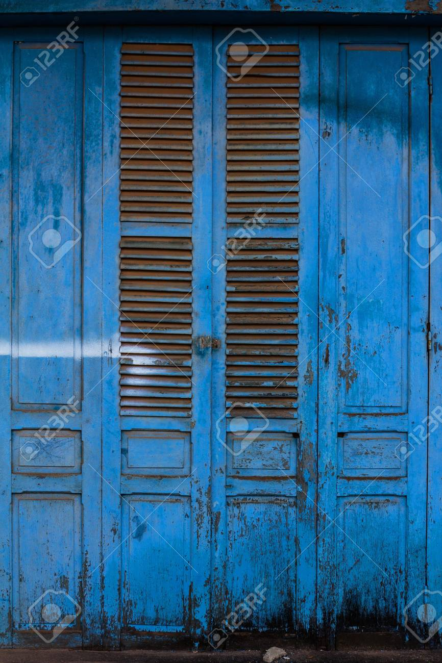 Blue wooden front door to the house Stock Photo - 21015285