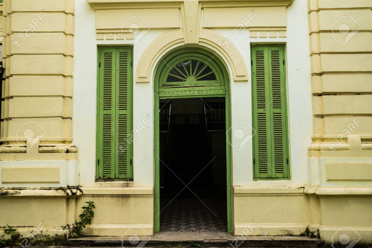 Green vintage wooden windows and door on yellow wall colonial style building from Vientiane & Green Vintage Wooden Windows And Door On Yellow Wall Colonial ... Pezcame.Com