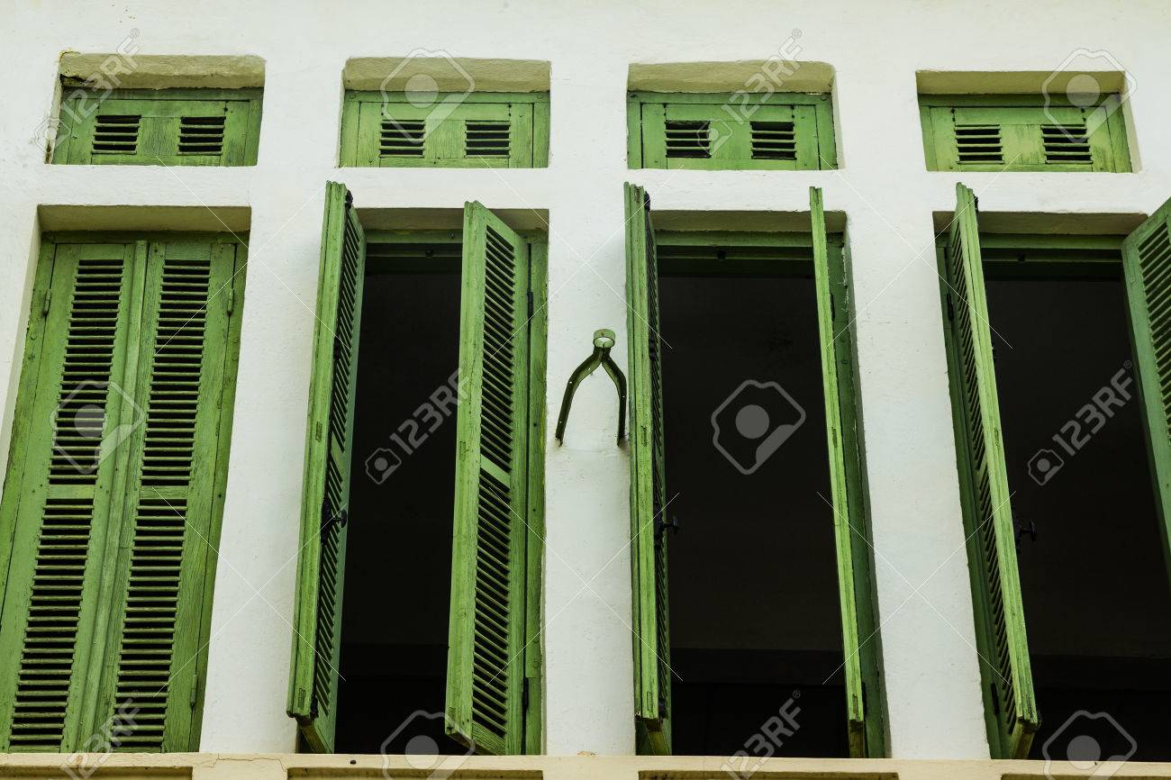 Green Vintage Wooden Windows Colonial Style Building From Vientiane