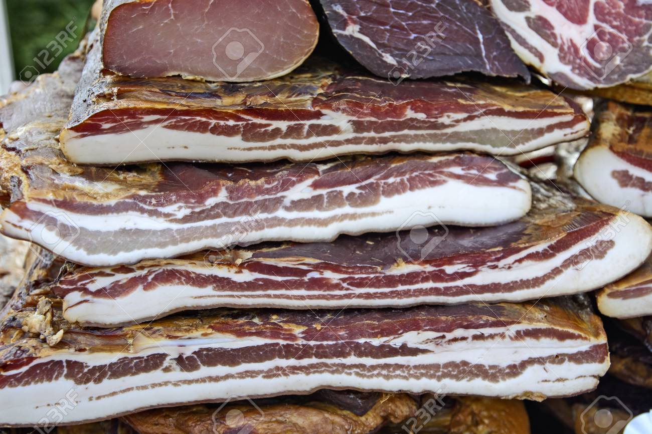 Homemade bacon on the table exposed for sale. Stock Photo - 98855286