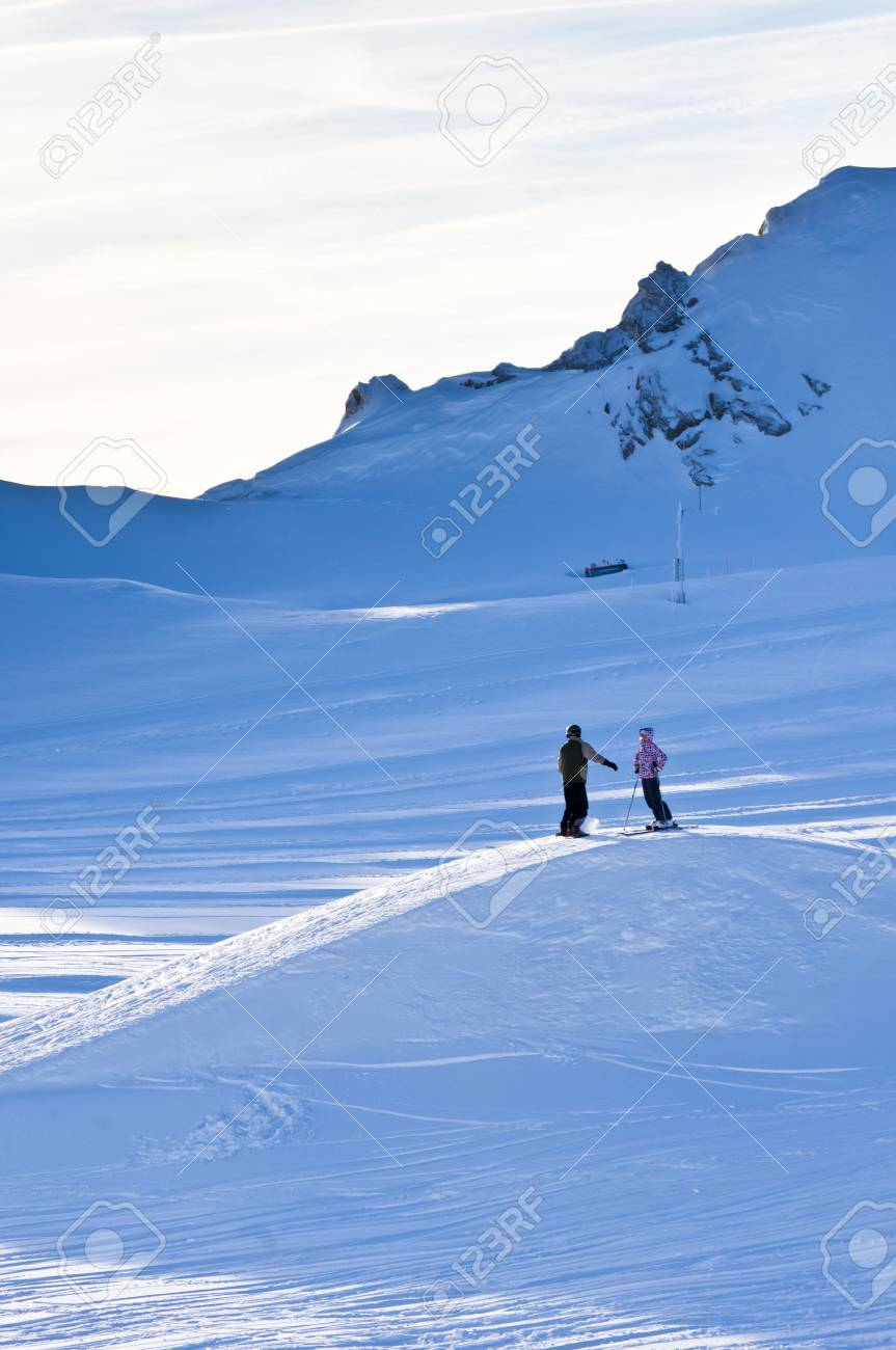 Two skiers near the top of Kaprun glacier Stock Photo - 18752204