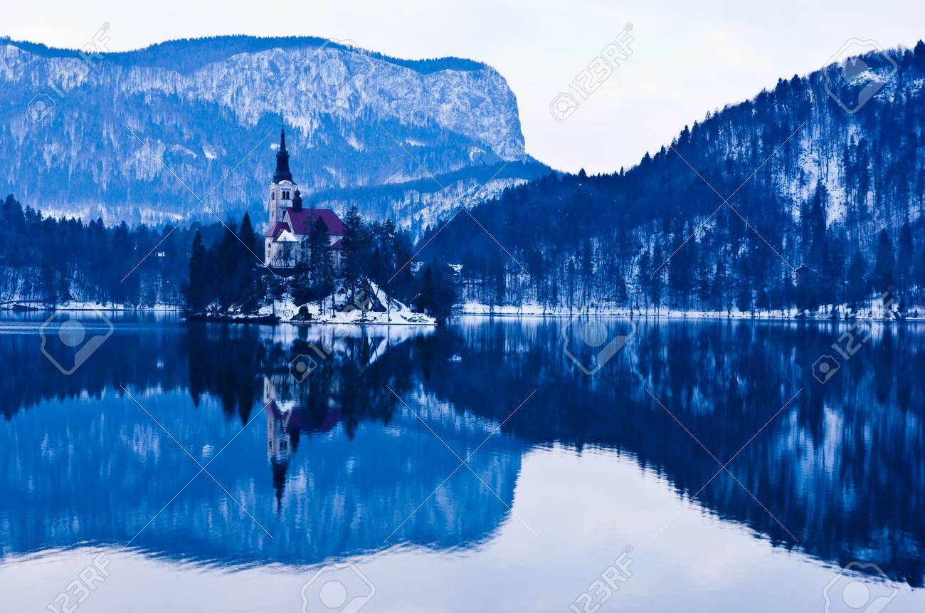 Early morning on lake Bled and reflection of a church on small island, Slovenian Alps Stock Photo - 19046221