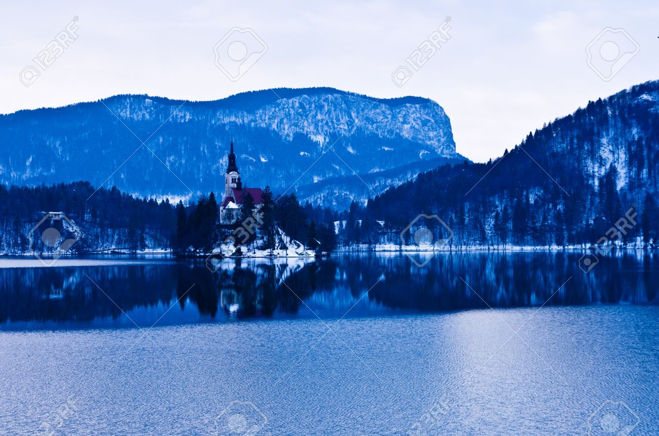 Winter morning and thin ice reflections on the lake Bled, Slovenia Stock Photo - 19046226
