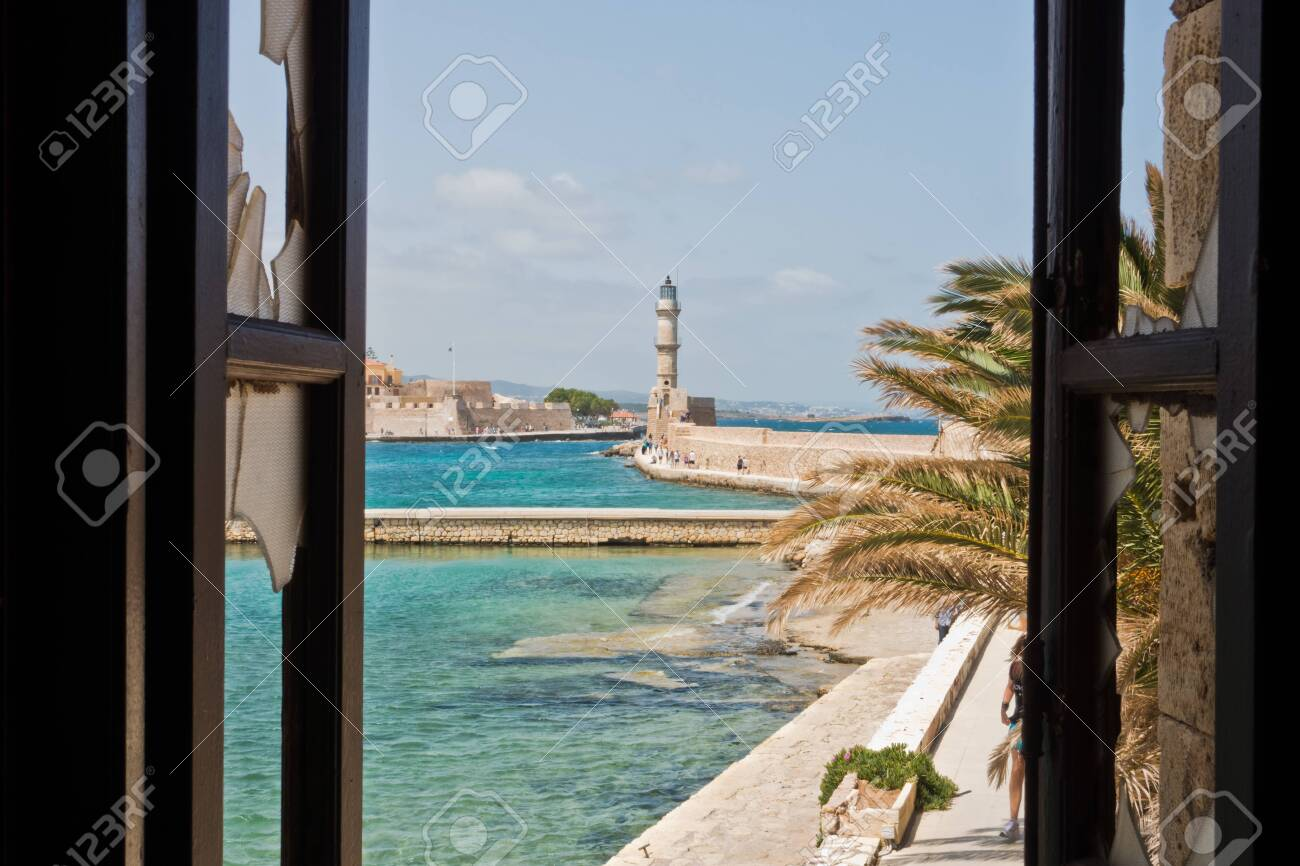 A view of a lighthouse at the old Venetian harbor, city of Chania, Crete island, Greece - 120589327