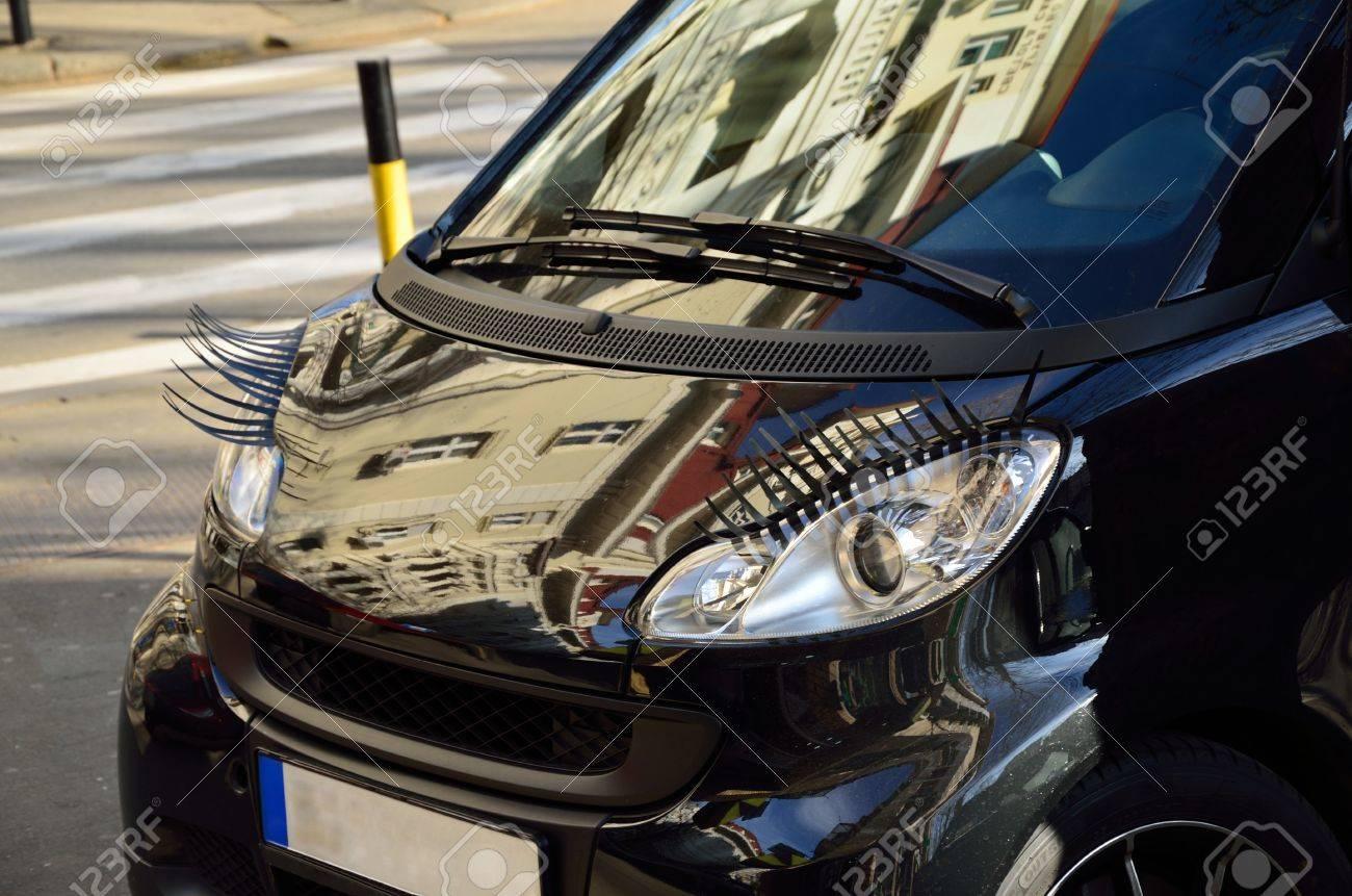 Car With Eyelashes On Headlightsas Feminine Symbol Stock Photo