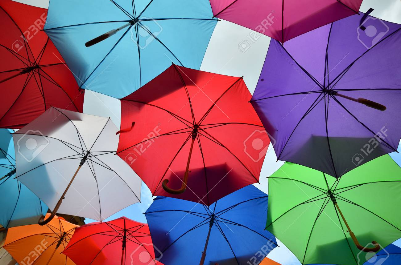 ba46f32f4 Colorful umbrellas of different bright colors with parts of cloudy sky Stock  Photo - 63674807