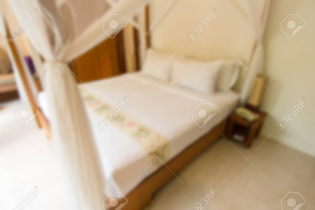 luxury king size bed. Archivio Fotografico - Blurry Background Of Luxury King Size Bed, Located In The Bedroom With Romantic Atmosphere. Bed S