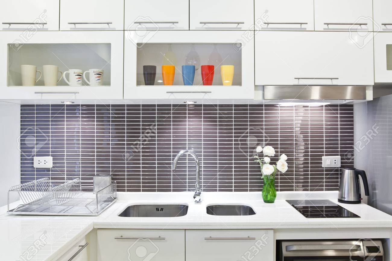 Stainless steel sink on top white granite Stock Photo - 14401529
