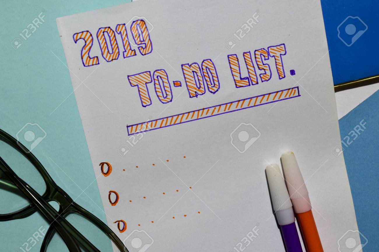 Top view 2019 TO DO LIST text with alarm clok, marker and eyeglasses for business presentation mock up for adding your list - 113053464