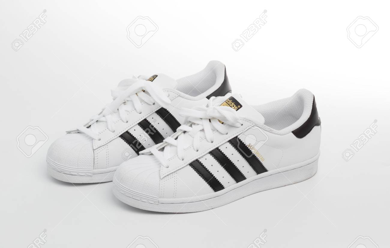 Adidas Superstar Shoes On White.. Stock