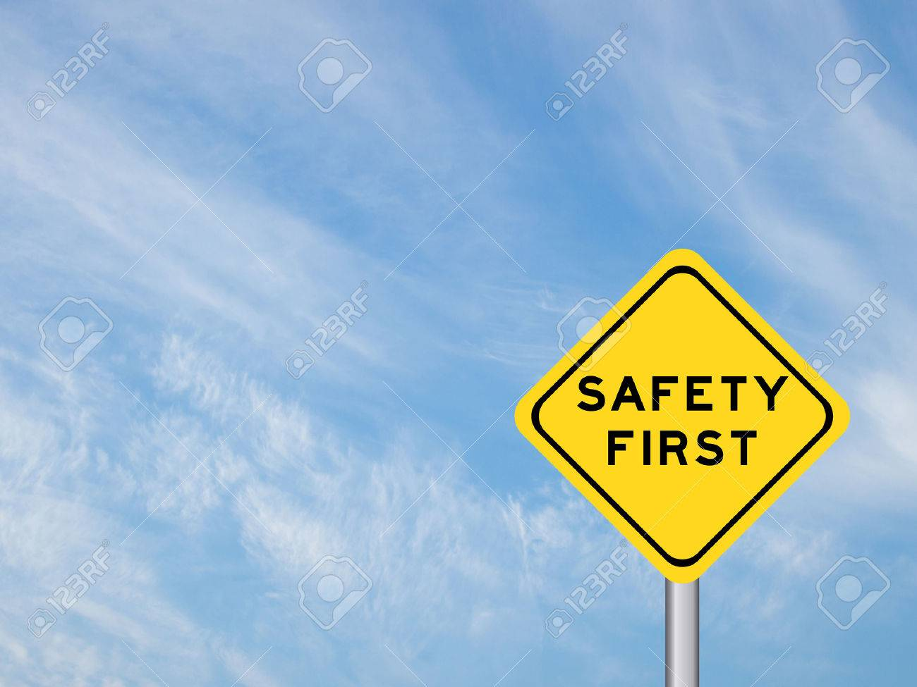 """wording """"Safety first"""" on yellow traffic sign on the blue sky - 57768829"""