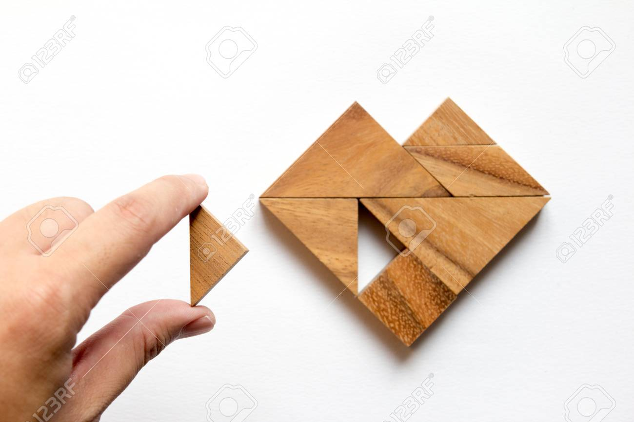 Man held piece of tangram puzzle to fulfill the heart shape on white background (Concept of love) - 71044683