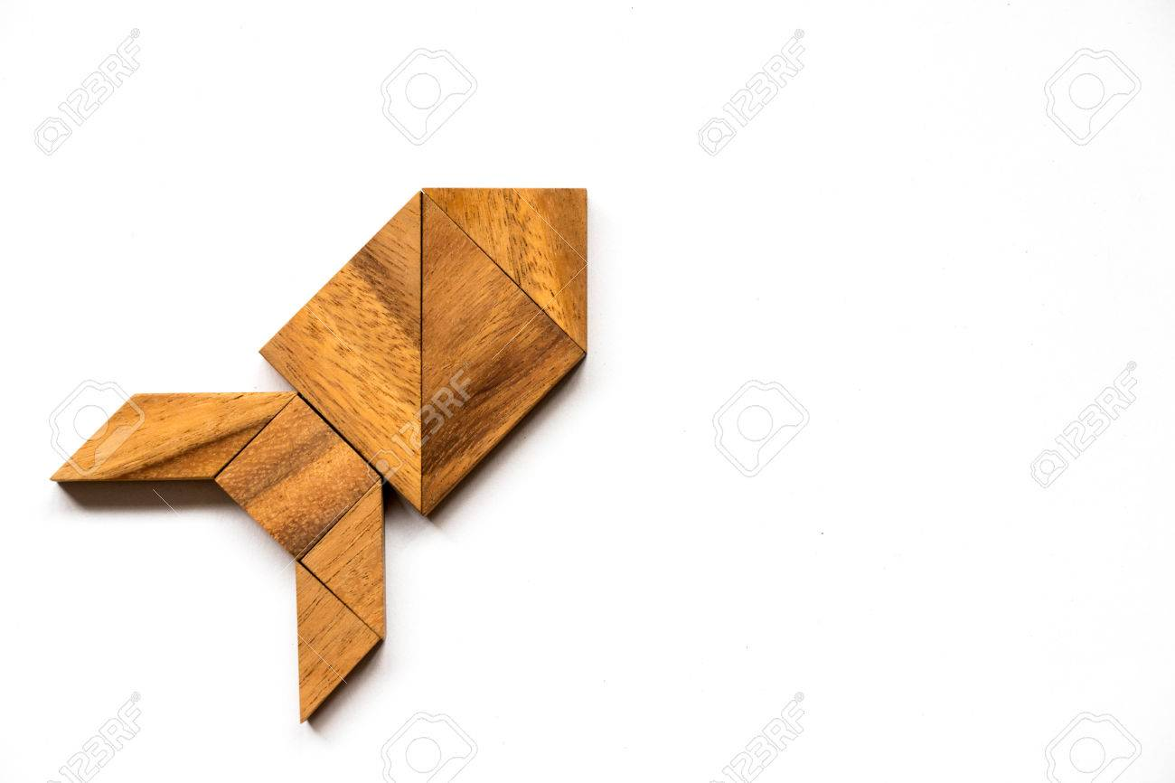 Wooden tangram puzzle in rocket shape on white background (Concept for new experience, start project) - 77517334