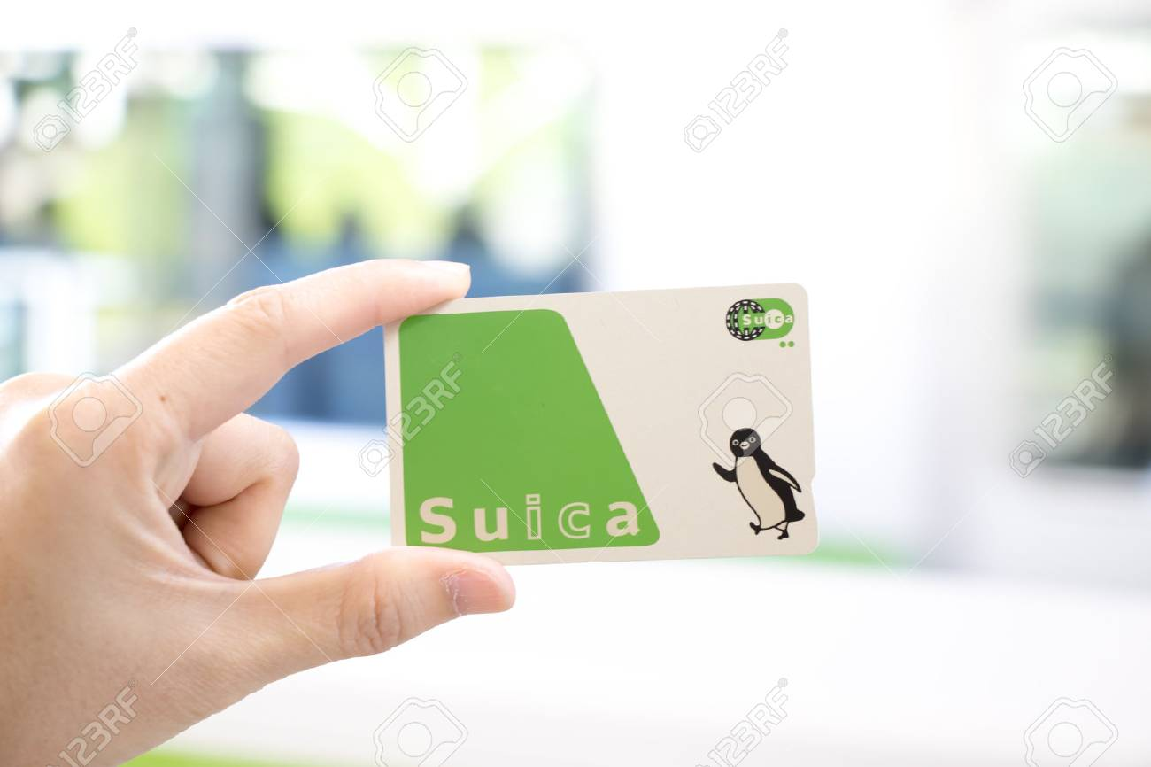 Tokyo, Japan - April 23, 2017 : Man hold Suica pass with the blurred background, Suica is a prepaid card for travelling with train, bus and shopping in Japan. - 79206593