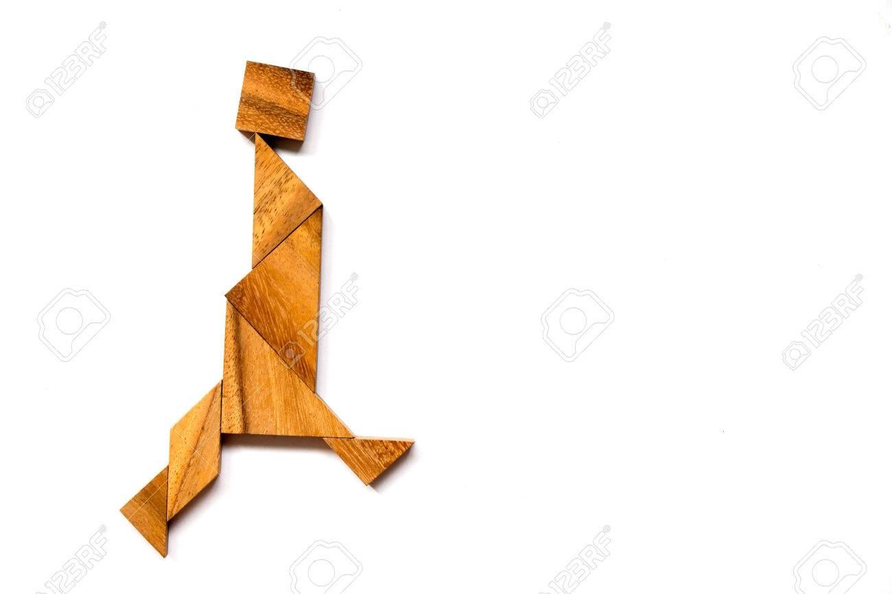 Wooden tangram puzzle in walking man shape on white background - 80384600