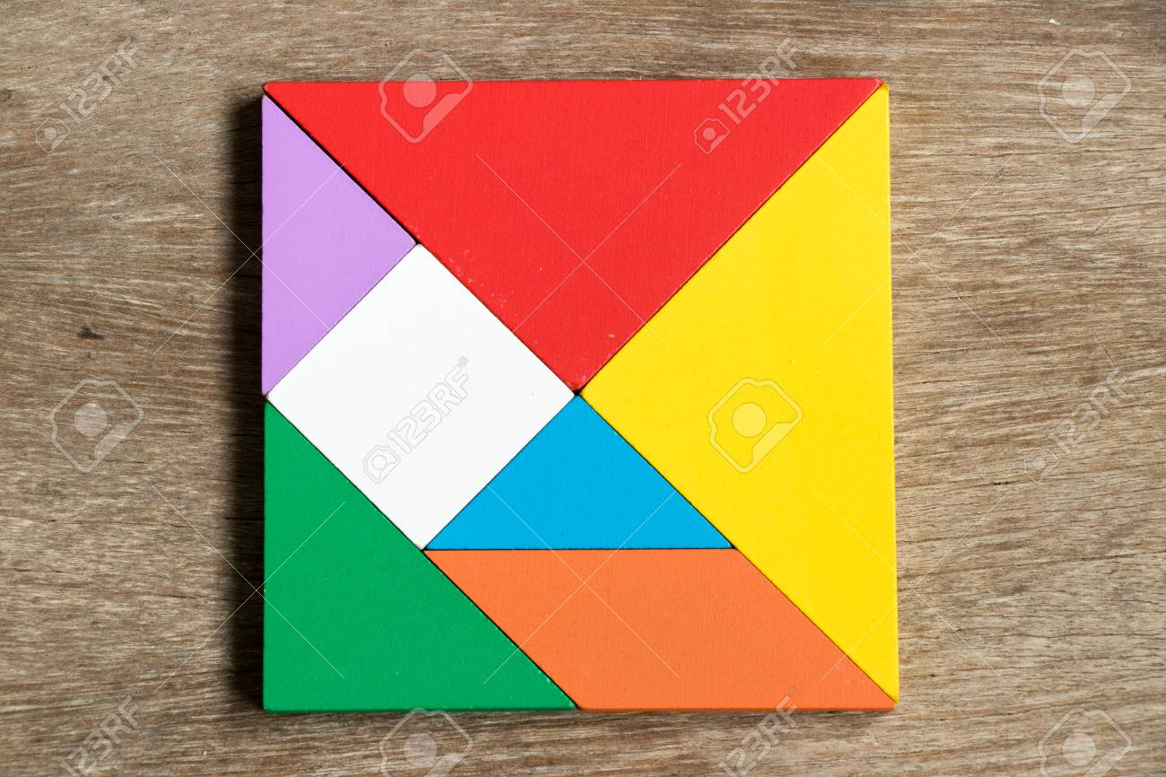 Colorful tangram puzzle in square shape on wood background - 86698916