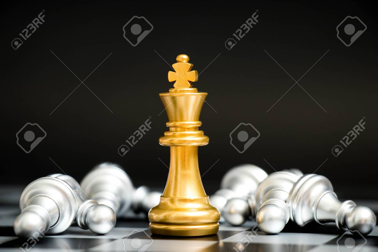 Gold king in chess game face with the another silver team on black background (Concept for company strategy, business victory or decision) - 89755235