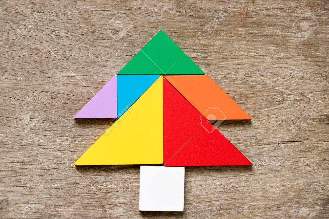 Colorful Tangram Puzzle In Pine Or Christmas Tree Shape On Wood ...