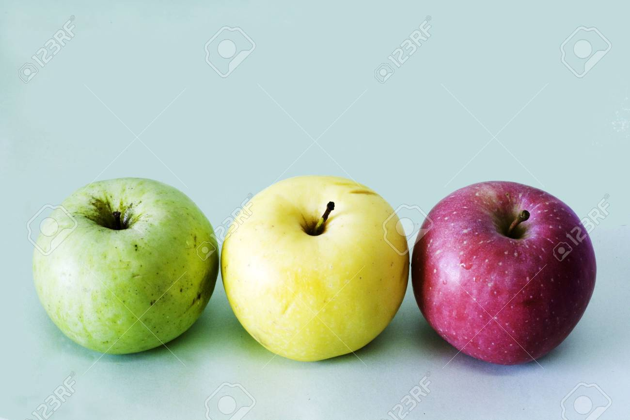 three apples on the table Stock Photo - 7574632